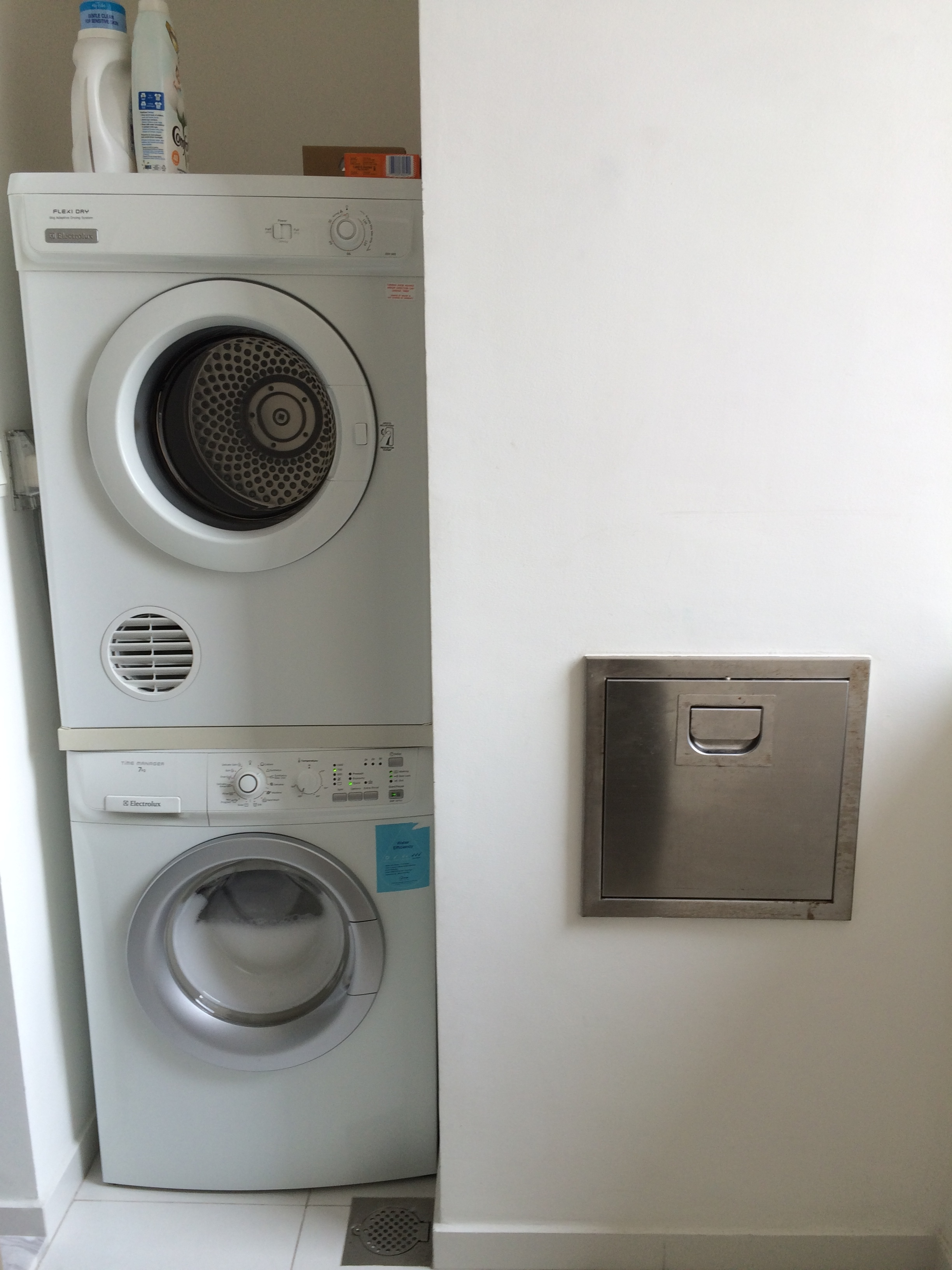 Washer, Dryer, And Trash Chute In Wet Kitchen